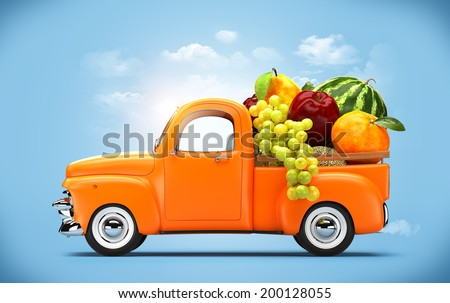 Pickup truck loaded by fruits.  - stock photo