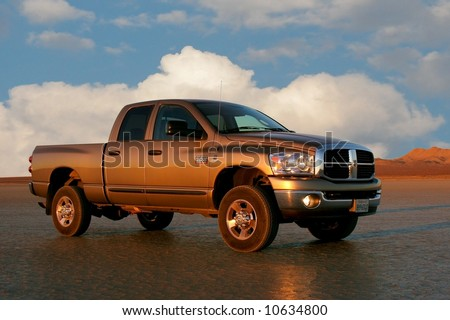 Pickup truck on dry lakebed - stock photo