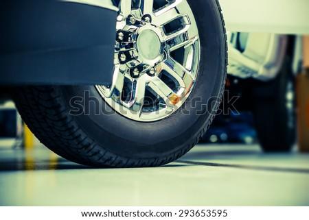 Pickup Truck Wheels and Tires Closeup Photo. Heavy Duty Truck Wheels - stock photo
