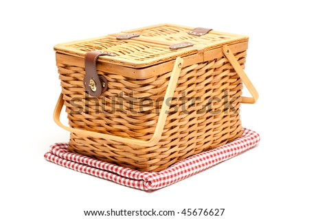 Picnic Basket and Folded Blanket Isolated on a White Background. - stock photo