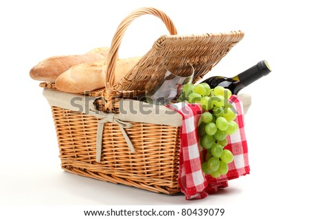 Picnic basket filled with fruit,bread and red wine. - stock photo