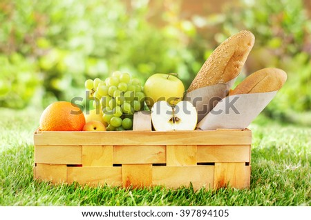 Picnic Basket Fresh Food Bread Bio Organic Fruit Green Natural Background Selective Focus - stock photo