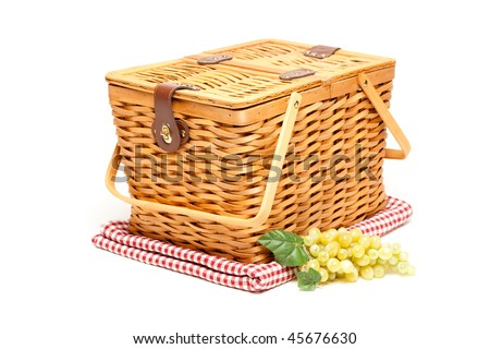 Picnic Basket, Grapes and Folded Blanket Isolated on a White Background. - stock photo