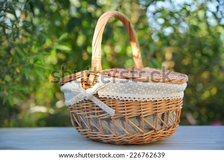 Picnic basket, isolated on white - stock photo