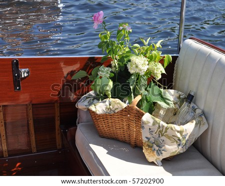 Picnic basket on a boat - stock photo