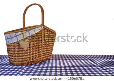 Picnic Basket On The Blue Checkered Tablecloth Isolated On White Background - stock photo