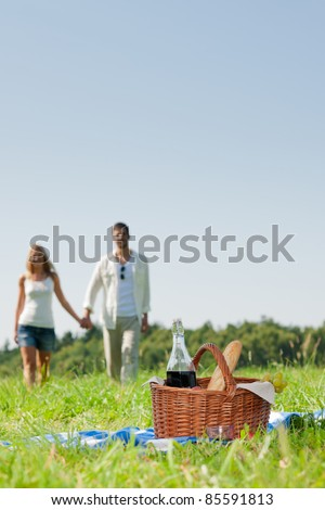Picnic basket - Romantic happy couple in meadows nature sunny day - stock photo