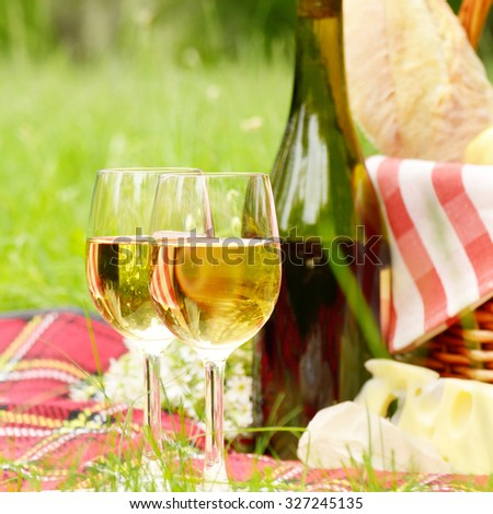 Picnic basket with apples bread cheese and wine