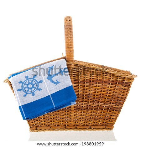 Picnic basket with boat napkin isolated over white background - stock photo
