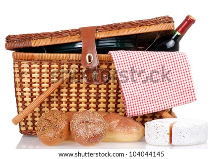 Picnic basket with bread cheese and wine - stock photo