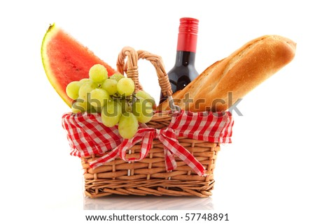 Picnic basket with bread wine grapes and water melon - stock photo