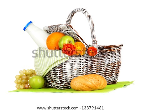 Picnic basket with fruits and bottle of milk, isolated on white - stock photo