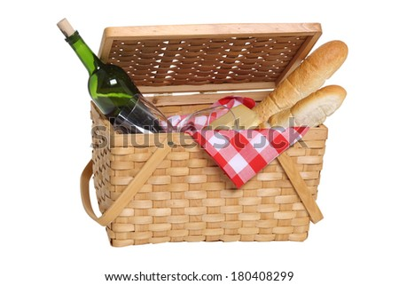 Picnic basket with wine and bread, cut out on white background - stock photo