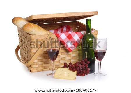 Picnic basket with wine, bread and cheese, cutout on white background - stock photo
