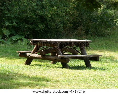 picnic  bench in park - stock photo