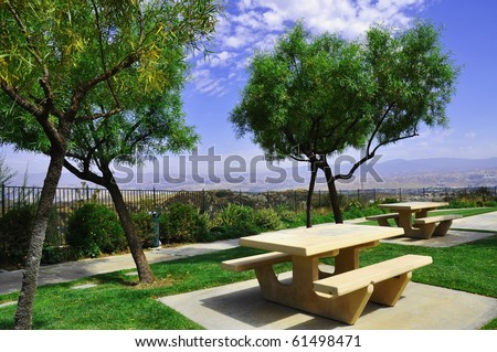 Picnic benches in a park setting - stock photo