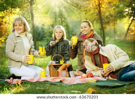 Picnic.Happy Family in Autumn Park - stock photo