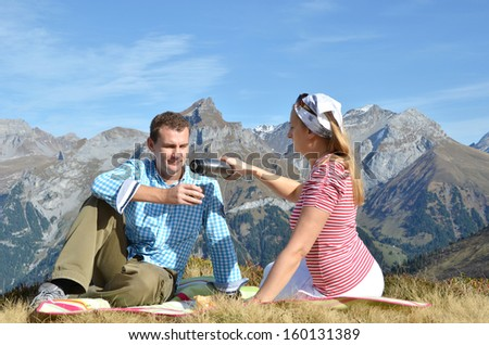 Picnic in Alpine meadow. Switzerland - stock photo