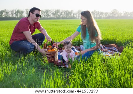 Picnic on the grass. Happy family