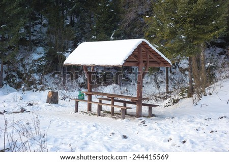 Picnic place for tourists in winter forest - stock photo