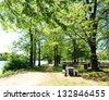 Picnic Table and Barbecue Grill at State Park - stock photo