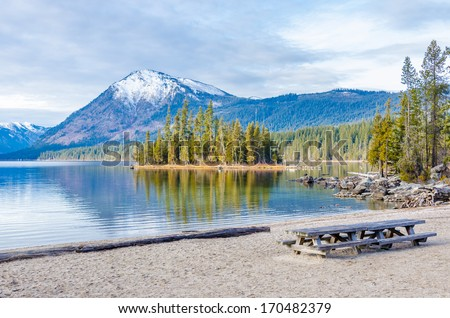 Picnic table at the beach of a lake, Vancouver, Canada - stock photo