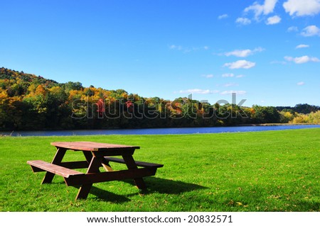 Picnic table in beautiful park during autumn
