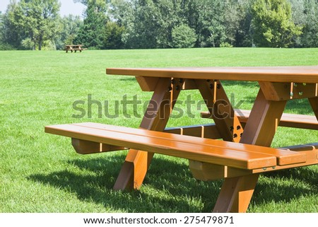 Picnic table on a green meadow - stock photo