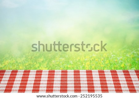 Picnic table on the summer field in sunlight - stock photo