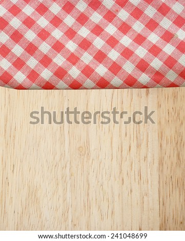 picnic tablecloth on old wooden table top view - stock photo
