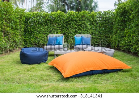 Picnic time in front yard with green fence - stock photo