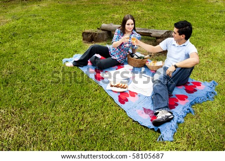 Picnic with young couple in spring
