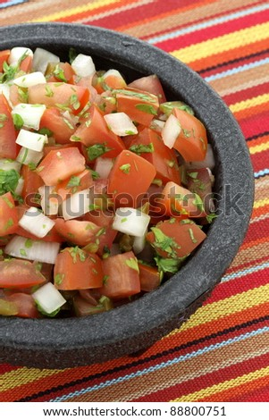 pico de gallo also called salsa fresca, is a fresh, uncooked condiment made from chopped tomato, white onion,cilantro and chilis