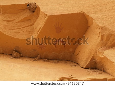 Pictographs painted on underside of cliff by prehistoric Native American(s). Some people think these paintings represent a supernova. Chaco Canyon, New Mexico, USA. - stock photo