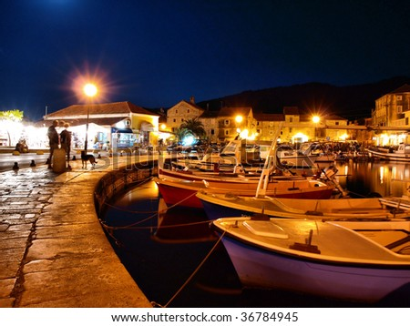 Pictorial harbor at night - stock photo