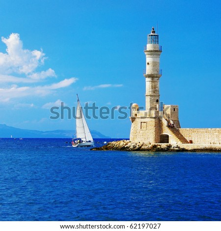 pictorial scene in Chania with light house and yacht - stock photo