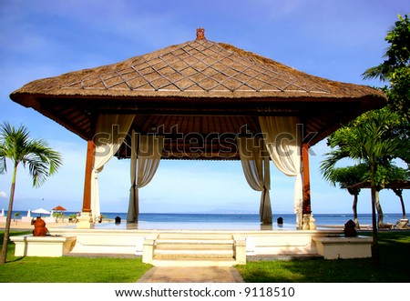pictorial view with Balinese bower on the beach - stock photo