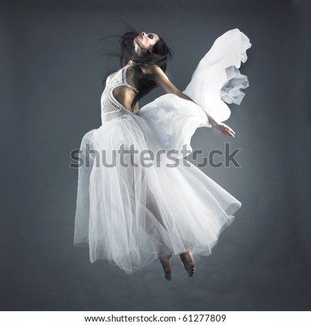 Picture a beautiful fairy flying girl in white dress - stock photo