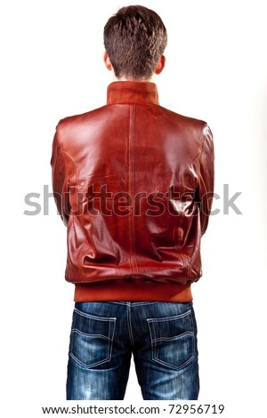 Picture a guy who stands behind the camera. Dressed in jeans and leather jacket. - stock photo
