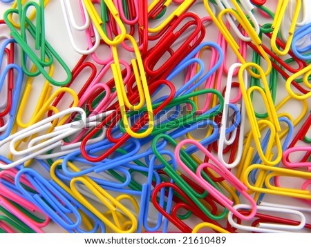 Picture background of many multi colored paperclips