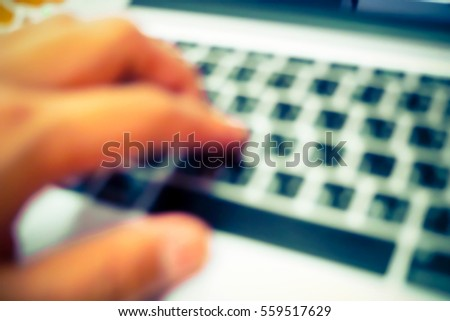 Picture blurred  for background abstract and can be illustration to article of hand on keyboard close up