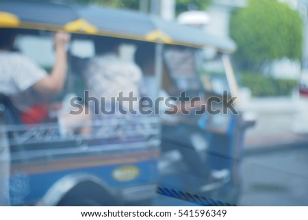 Picture blurred  for background abstract and can be illustration to article of threewheeler classic motorised tuk-tuk taxi in Bangkok, Thailand