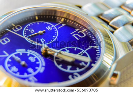 Picture close-up of wrist watches with blue dial