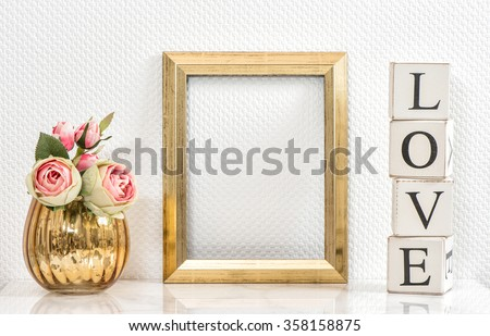Picture frame and pink roses. Valentines Day concept. Mock up with golden frame and flowers with space for your picture or text - stock photo