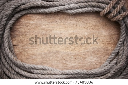 picture frame of rope on a old wooden background - stock photo