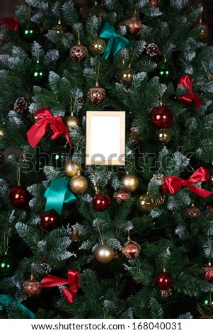 Picture frame on a New Year tree - stock photo