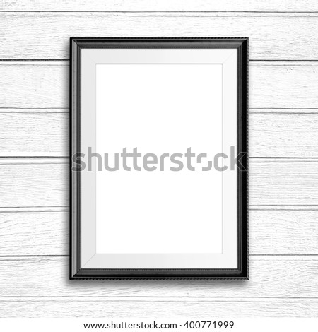 Picture frame on white wood wall. - stock photo