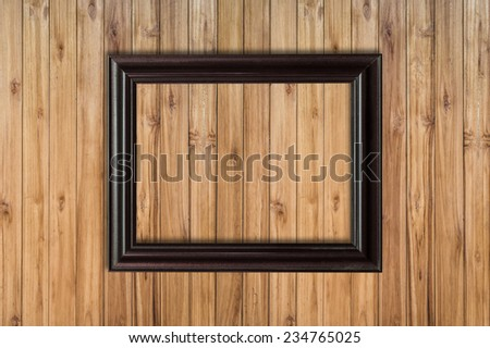 Picture frame on wood background with space