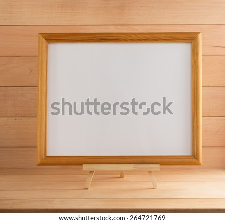picture frame on wooden background - stock photo