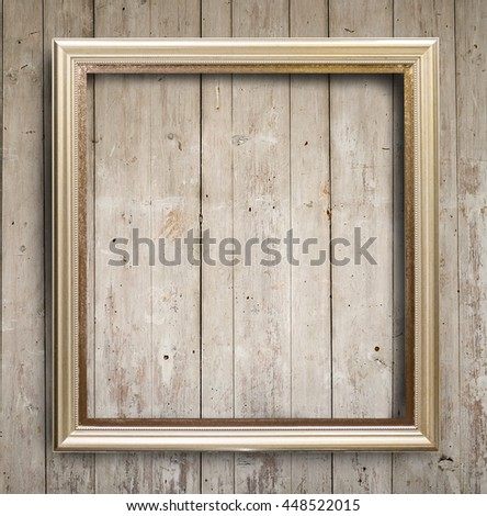 Picture frame on wooden wall. for your design